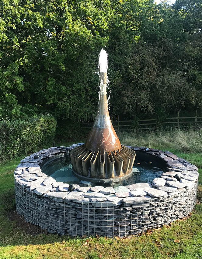 water feature made from upcycled aircraft engine